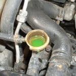 Oil in Coolant Reservoir - Causes, Testing & Solutions