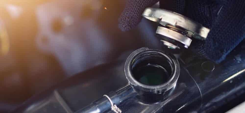 6 Causes of Oil in Coolant Reservoir & What to do