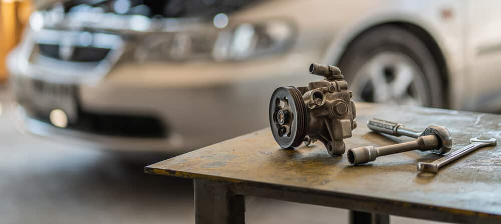 6 Symptoms of a Bad Power Steering Pump, Location & Replacement Cost